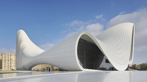 Zaha Hadid s buildings are distinctively neofuturistic, characterised by the  powerful, curving forms of her elongated structures [1] with  multiple perspective points and fragmented geometry to evoke the chaos of modern life