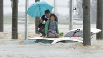 Torrential rains in the area of the Japanese town of Minamioidzu triggered massive floods as Kinugawa river broke its banks