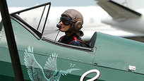 British aviator Tracey Curtis-Taylor flies her 1942 Boeing Stearman Spirit of Artemis aircraft into land at Sydney Airport in Sydney, Australia, Saturday, Jan. 9, 2016. The 53 year-old aviator set out from Britain in October 2015 to recreate Amy Johnson s 1930 flight from Britain to Australia, a 13,000-mile solo flight in a vintage open cockpit biplane flying across 23 countries. She flew on board the 1942 Boeing Stearman Spirit of Artemis